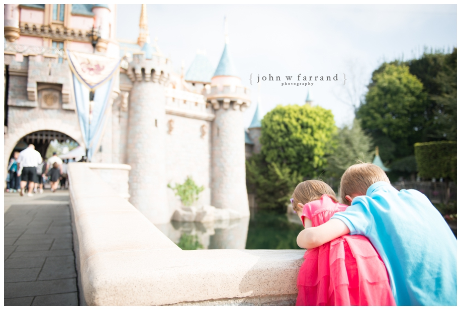 Disneyland-Family-Photographer - Watching the ducks in front of Sleeping Beauty Castle.