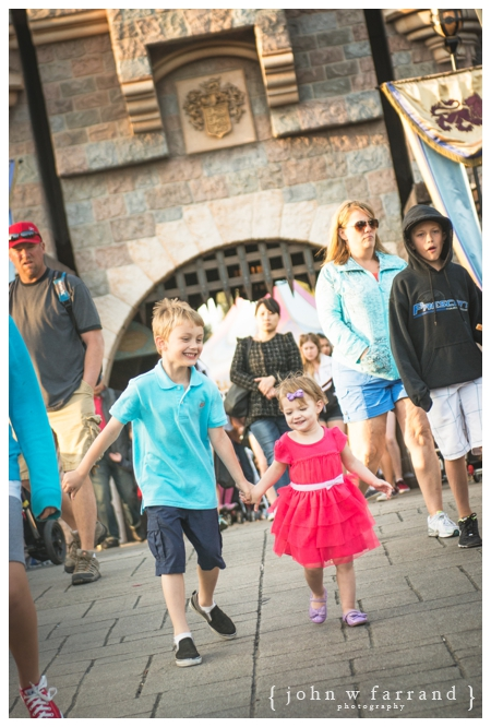 Disneyland Family Photographer - Only partially staged here.  Brother and sister loved running to and from the Castle!